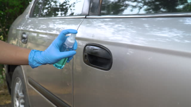 ms alcohol spray and wipe car door latch - latex glove stock videos & royalty-free footage
