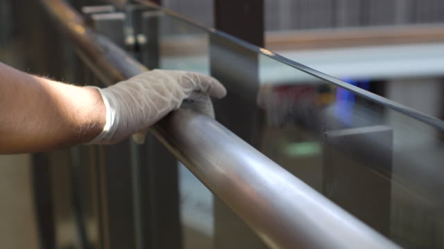 alcohol spray and wipe handrail - cleaning glove stock videos & royalty-free footage