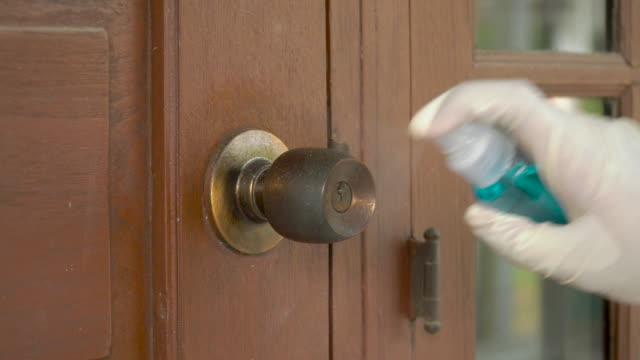 alcohol spray and wipe old doorknob - handle stock videos & royalty-free footage