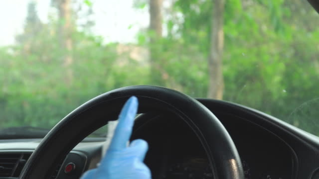 alcohol spray and wipe steering wheel - medical glove stock videos & royalty-free footage