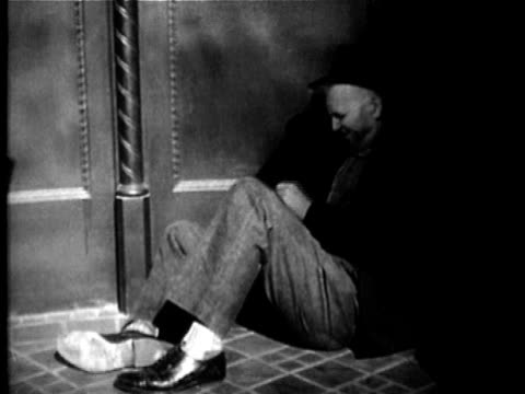 1949 B/W MONTAGE Alcoholic man drinking and passing out in doorway, USA, AUDIO