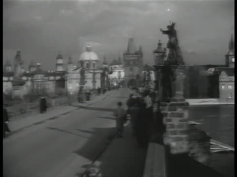 vídeos de stock, filmes e b-roll de prague czechoslovakia cu 'alcron praha' travel sticker ls people walking on charles bridge xha cityscape xha ws cityscape w/ trams moving on street... - stare mesto