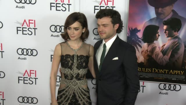 Alden Ehrenreich Lily Collins at Audi Celebrates Opening Night of 'Rules Don't Apply' At AFI Fest 2016 on November 10 2016 in Hollywood California
