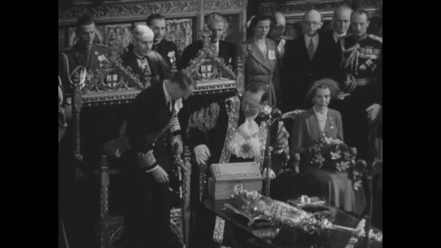 aldermen the lord mayor of london and royal visitors stand as vo the danish national anthem is played inside guildhall in the city of london / lord... - lord mayor of london city of london stock videos & royalty-free footage