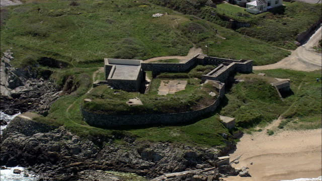 alderney,  fort tourgis - aerial view - helicopter filming,  aerial video,  cineflex,  establishing shot,  guernsey - guernsey stock videos & royalty-free footage