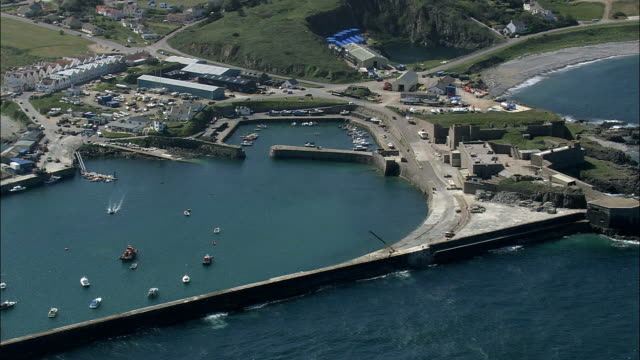 alderney harbour - aerial view - helicopter filming,  aerial video,  cineflex,  establishing shot,  guernsey - channel islands england stock videos & royalty-free footage