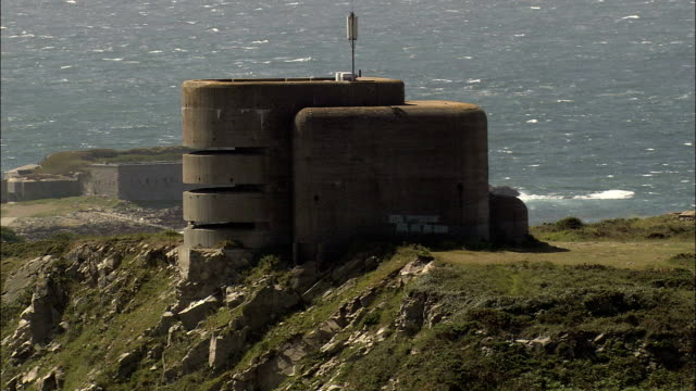 alderney,  ww11 bunker - aerial view - helicopter filming,  aerial video,  cineflex,  establishing shot,  guernsey - guernsey stock videos & royalty-free footage