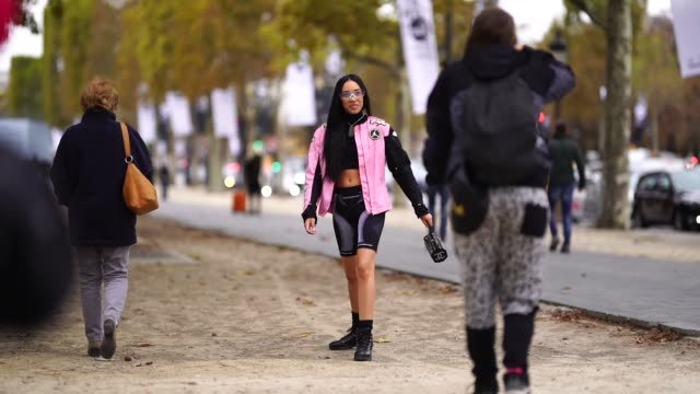 aleali may wears a black and pink jacket, a cropped top, short leggings, outside chanel, during paris fashion week womenswear spring/summer 2019 on... - legging stock-videos und b-roll-filmmaterial