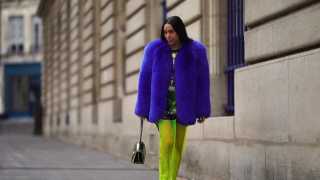 aleali may wears a blue fluffy coat, yellow pants, a balmain bag, outside balmain, during paris fashion week womenswear spring/summer 2019, on... - fluffy stock videos & royalty-free footage