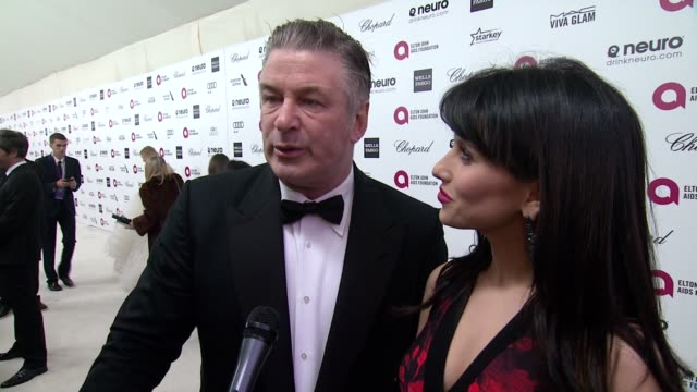 interview alec baldwin and hilaria baldwin on being at the event and on elton john at the 23rd annual elton john aids foundation academy awards... - alec baldwin stock videos and b-roll footage