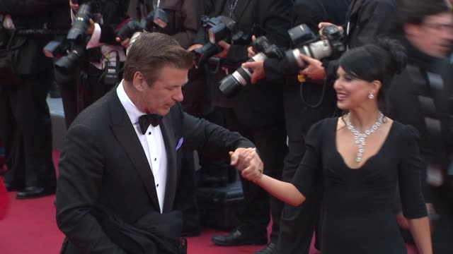 alec baldwin and hilaria thomas at closing ceremony therese desqueyroux premiere 65th cannes film festival at lumiere on may 27 2012 in cannes france - alec baldwin stock videos & royalty-free footage
