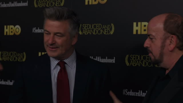 alec baldwin and james toback posing for paparazzi on the red carpet at the time warner center - time warner center stock videos & royalty-free footage