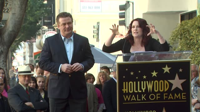 alec baldwin and megan mullally at the alec baldwin honored with a star on the hollywood walk of fame at hollywood ca - alec baldwin stock videos & royalty-free footage