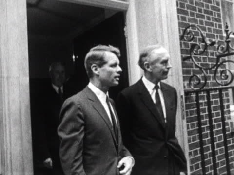 alec douglas-home and robert kennedy walk out of 10 downing street and pose for photographs. - alec douglas home video stock e b–roll