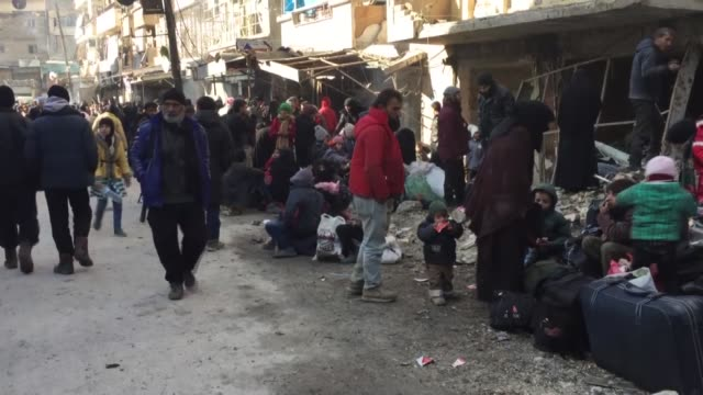 aleppo citizens wait for the arrival of a convoy that started to head back to eastern aleppo after being attacked by iranianbacked shia militias on... - head back stock videos & royalty-free footage