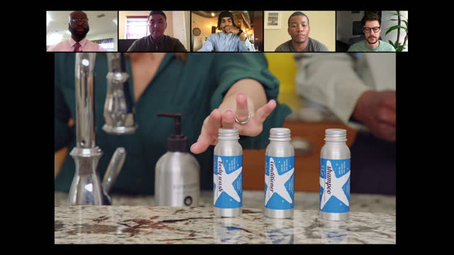 alert group of five customers watch infomercial pitch for shower products - salesman stock videos & royalty-free footage