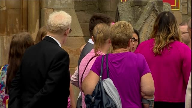 GVs of pink themed funeral in Coatbridge SCOTLAND North Lanarkshire Coatbridge EXT Family and friends arriving for the funeral service of 6yearold...