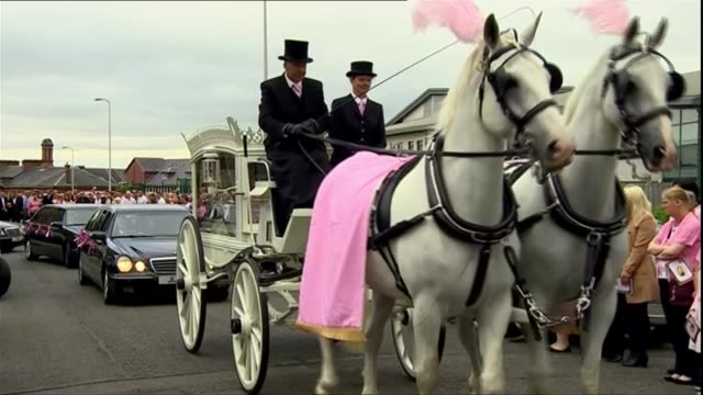 Hundreds attend funeral in Coatbridge SCOTLAND North Lanarkshire Coatbridge SOT*** Horse and carriage carrying coffin along road for procession