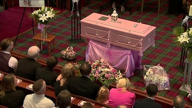 Hundreds attend funeral in Coatbridge SCOTLAND North Lanarkshire Coatbridge INT Pink coffin Alesha MacPhail's family sitting in pew