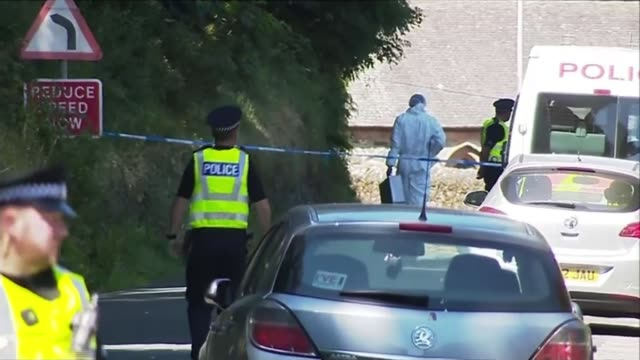 Teenage boy arrested 272018 SCOTLAND Isle of Bute EXT Police officers and forensic officer in street