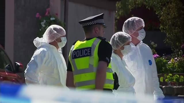 Teenage boy arrested 372018 SCOTLAND Isle of Bute INT Det Supt Stuart Houston press conference SOT Forensic officers and police officer in street...