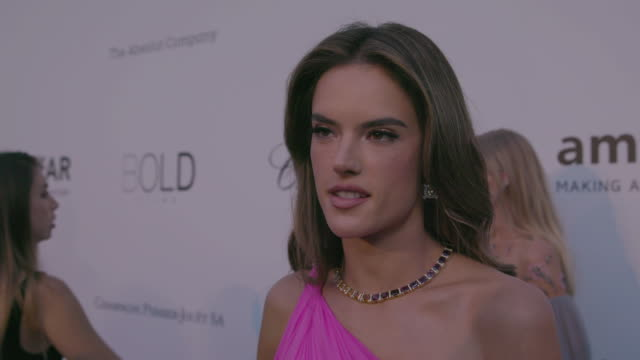 INTERVIEW Alessandra Ambrosio on being at amfAR at amfAR Gala Cannes 2018 at Hotel du CapEdenRoc on May 17 2018 in Cap d'Antibes France