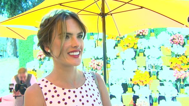 vídeos de stock, filmes e b-roll de interview alessandra ambrosio on coming back to the veuve clicquot polo classic talks about her polo style her recent trip to brazil and working on... - alessandra ambrosio