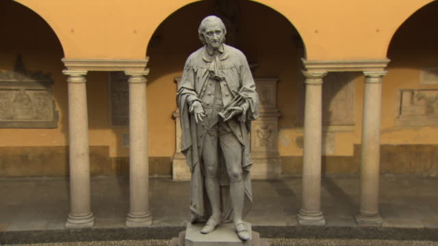 alessandro volta - white stone statue at pavia university in italy - male likeness stock videos & royalty-free footage