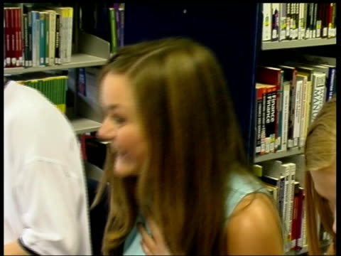 greater manchester hyde int teenage girls celebrating as reading their alevel results cs alevel results sheet showing a grades schoolgirl smiling... - receiving stock videos and b-roll footage