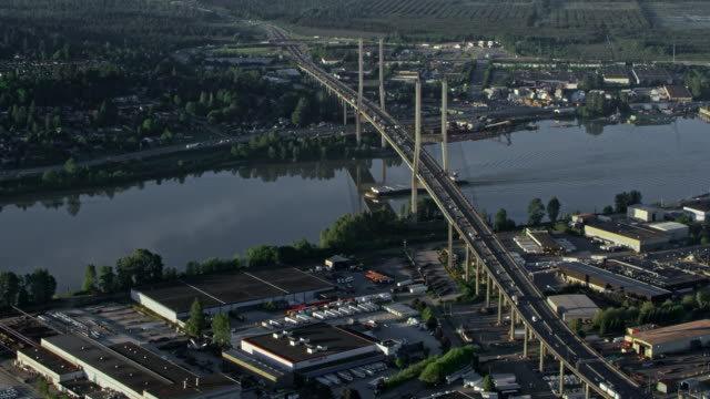 AERIAL Alex Fraser Bridge crossing the Fraser River in Delta, Canada