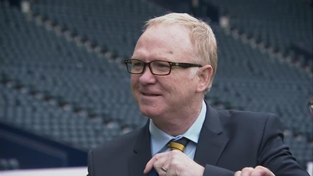 Alex McLeish named new Scotland manager SCOTLAND EXT Close shot 'McLeish' printed on Scotland jersey TILT UP Alex McLeish Alex McLeish posing for...