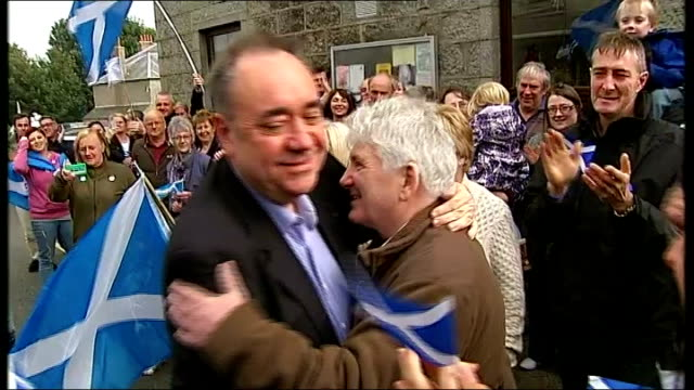 Aberdeenshire New Deer EXT Various of Alex Salmond MSP along and greeting crowds of people with Scottish Saltire flags