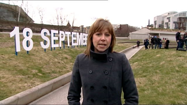 alex salmond sets date for vote on scottish independence edinburgh back view crew members putting up sign reading '18 september 2014' reporter to... - 2014 scottish independence referendum stock videos & royalty-free footage