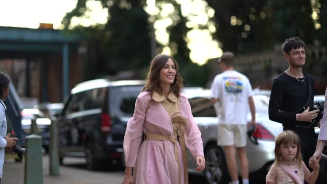 vídeos de stock, filmes e b-roll de alexa chung wears a pale pink transparent trench coat with a beige part a belt a bag blue jeans white sneakers during london fashion week september... - transparente