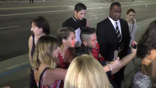 Alexa PenaVega and Carlos PenaVega filming Dancing With The Starsflash mobon Hollywood Blvd in Hollywood on September 10 2015 in Los Angeles...