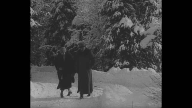 VS Alexander and Maria walking through a forest in deep snow