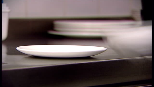 traces of poison found in cup at hotel int close shot cup and saucer put on kitchen surface / cups and saucers put in dishwasher and switch pressed - saucer stock videos and b-roll footage