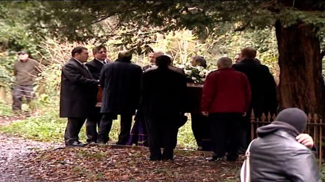 alexander litvinenko funeral: pallbearers carry coffin through cemetery; england: london: highgate cemetery: ext pallbearers take their places around... - highgate stock videos & royalty-free footage