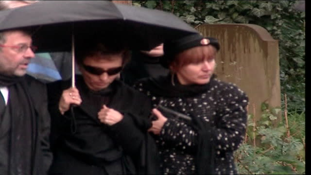 vídeos de stock, filmes e b-roll de alexander litvinenko poisoning: further radiation traces found: widow speaks out; lib ext marina towards under umbrella as comforted by woman - widow