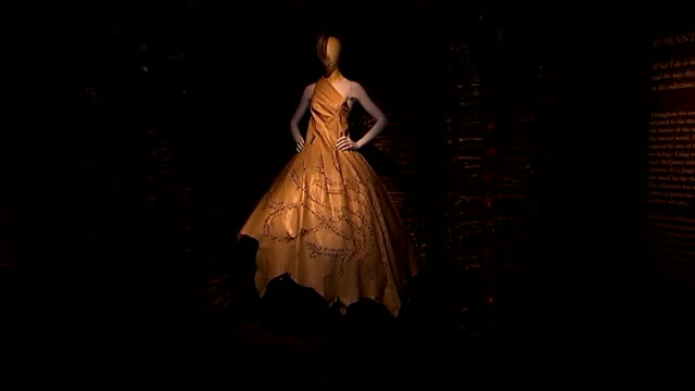 Alexander McQueen exhibition at Victoria and Albert Museum **Music heard intermittently SOT** INT Mannequins on display wearing Alexander McQueen...