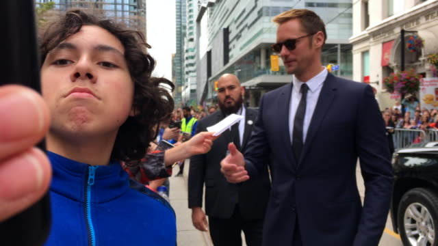 Alexander Skarsgard greets fans and signs autographs before entering the red carpet Celebrities attending this year 2018 TIFF The Toronto...
