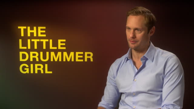 alexander skarsgard on how the writing of john le carre is very different to most screenwriting around at 'the little drummer girl' interviews - 62nd... - デビッド コーンウェル点の映像素材/bロール