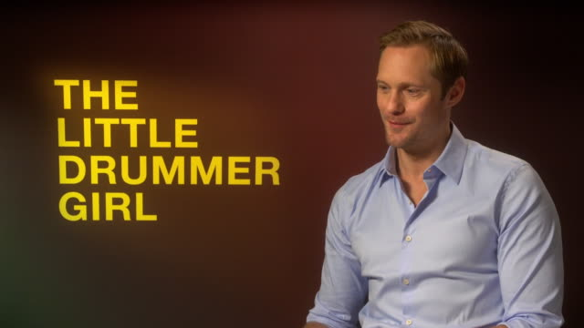 INTERVIEW Alexander Skarsgard on keeping the 1970s feel to the show at 'The Little Drummer Girl' Interviews 62nd BFI London Film Festivalon October...