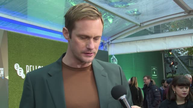alexander skarsgard on shooting a scene with john le carre, the parallels with real life and reasons for coming onboard on october 14, 2018 in... - デビッド コーンウェル点の映像素材/bロール
