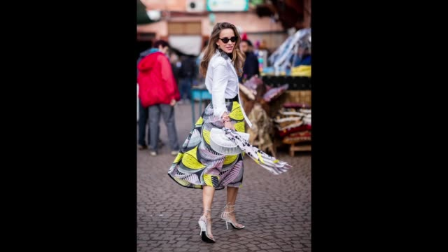 alexandra lapp is seen wearing a flared skirt printed with pink yellow and black patterns combined with a plain bowed white shirt a matching silk... - pink shirt stock videos and b-roll footage