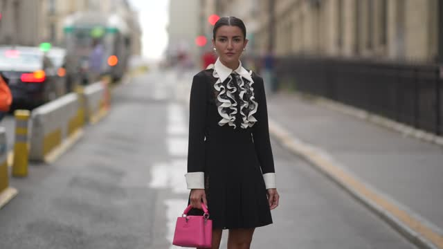 alexandra pereira wears pearl earrings, a dress made of a white striped by black lace ruffled chest with black sleeves shirt and a black pleated /... - fashion collection stock videos & royalty-free footage