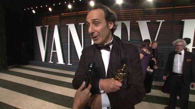 interview alexandre desplat at the 2015 vanity fair oscar party hosted by graydon carter at the wallis annenberg center for the performing arts on... - wallis annenberg center for the performing arts stock videos and b-roll footage