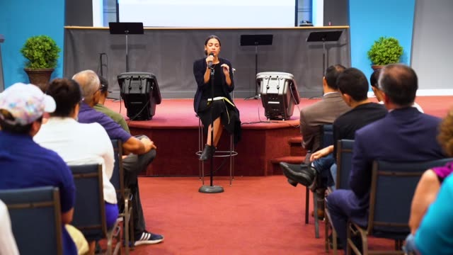 alexandria ocasiocortez democratic candidate running for new york's 14th congressional district answers questions at a town hall event september 19... - town hall meeting stock videos and b-roll footage