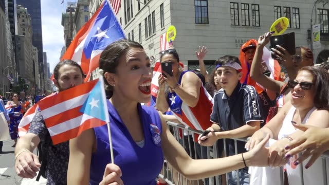 Alexandria OcasioCortez greets crowd during the annual Puerto Rican Day Parade via 5th Avenue in Manhattan New York City USA AOC is an American...