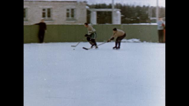 Alexei Leonov films a hockey game and trains with Pavel Belyayev